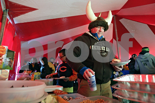 Rob Winner – rwinner@shawmedia.com<br /> <br /> Jay Jensen selects some food and a drink inside the Downs Tri-Valley Vikings spirit tent on the west side of Huskie Stadium on Friday morning before the start of the Class 1A championship game in DeKalb.