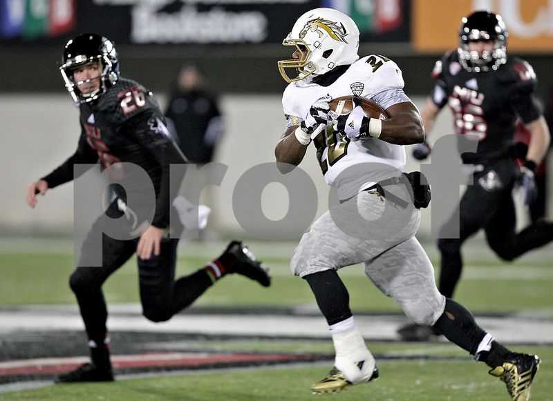 Monica Maschak - mmaschak@shawmedia.com<br /> Running back Tyler Fields carries the ball on a kick-off return in the fourth quarter against Northern Illinois on Tuesday, November 26, 2013. The Broncos lost 33-14.