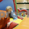 Rob Winner – rwinner@shawmedia.com<br /> <br /> Hope Batiste, 10, of DeKalb runs through an inflatable obstacle course at Cornerstone Christian Academy gymnasium on Friday afternoon in Sycamore. The Jumpin' Out Friday event includes five bounce houses and obstacle courses. The event is normally held every third Friday of the month, but a special Black Friday event was added this year.