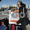 Monica Maschak - mmaschak@shawmedia.com<br /> Director of Communications & Marketing at Northern Illinois University Brad Hoey unloads magnetic signs for each team's locker room during preparations for the IHSA Football Championships at Huskie Stadium on Wednesday, November 27, 2013.