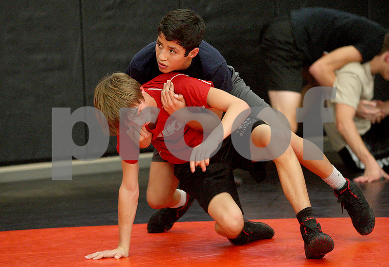 Monica Maschak - mmaschak@shawmedia.com<br /> DeKalb sophomore Ulissies Jacobo works on a technique with a partner during wrestling pratice. Jacobo will look to make an impact for the Barbs in the 106-pound weight class this season.