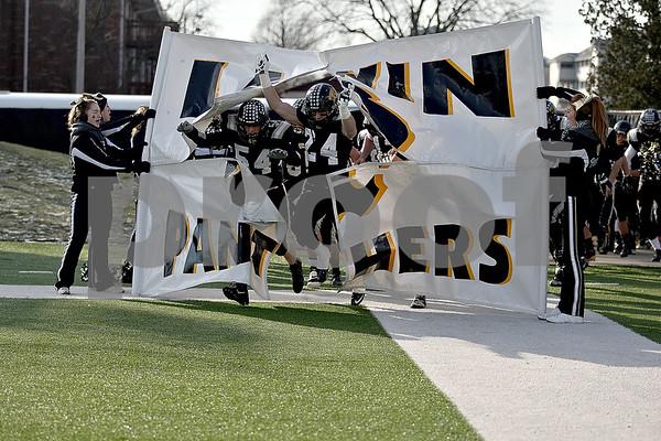 Monica Maschak - mmaschak@shawmedia.com<br /> The Lena-Winslow Panthers take the field for the IHSA Class 1A Football Championships at Huskie Stadium on Friday, November 29, 2013.