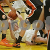 Rob Winner – rwinner@shawmedia.com<br /> <br /> Sycamore's Logan Wright tries to control a loose ball under the Spartans' basket in the second quarter during a game against Sandwich at the Strombom tournament in Sycamore, Ill., Monday, Nov. 25, 2013.