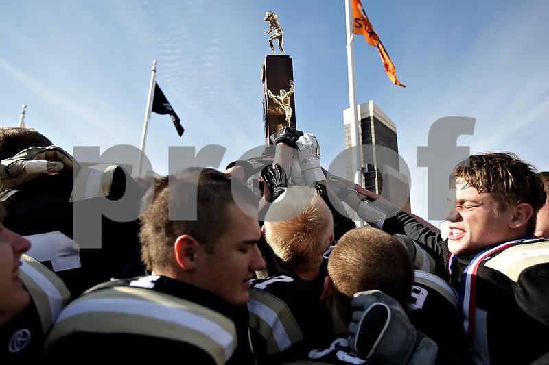 Monica Maschak - mmaschak@shawmedia.com<br /> The Panthers hoist their IHSA Class 1A Football Championship trophy after beating Tri-Valley 28-21 at Huskie Stadium on Friday, November 29, 2013.