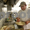 Monica Maschak - mmaschak@shawmedia.com<br /> Chef Sergio Noriega drops two orders of fish into the fryer after dipping them into batter at O'Leary's Restaurant and Pub in downtown DeKalb on Friday, November 22, 2013. O'Leary's serves their Captain Morgan Fish Fry every Friday.