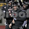 Monica Maschak - mmaschak@shawmedia.com<br /> Teammates congratulate quarterback Jordan Lynch on one of his touchdowns in the third quarter of the last home game of the season against Western Michigan on Tuesday, November 26, 2013. The Huskies won 33-14.