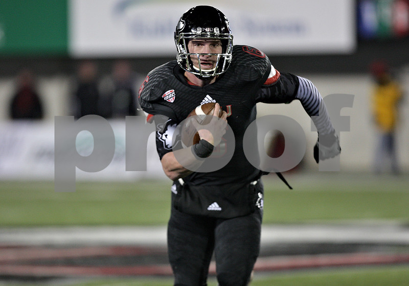 Monica Maschak - mmaschak@shawmedia.com<br /> Quarterback Jordan Lynch gains a first down in the fourth quarter of the last home game of the season against Western Michigan on Tuesday, November 26, 2013. Lynch had over 300 rushing yards in this game alone. The Huskies won 33-14.