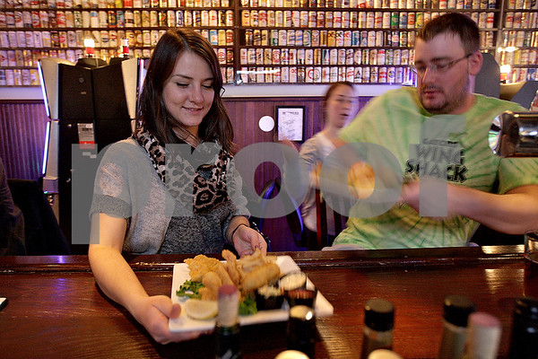 Monica Maschak - mmaschak@shawmedia.com<br /> Samantha Sobiech and Michael McCarthy are served their fish fry dinner at O'Leary's Restaurant and Pub in downtown DeKalb on Friday, November 22, 2013. O'Leary's serves their Captain Morgan Fish Fry every Friday.