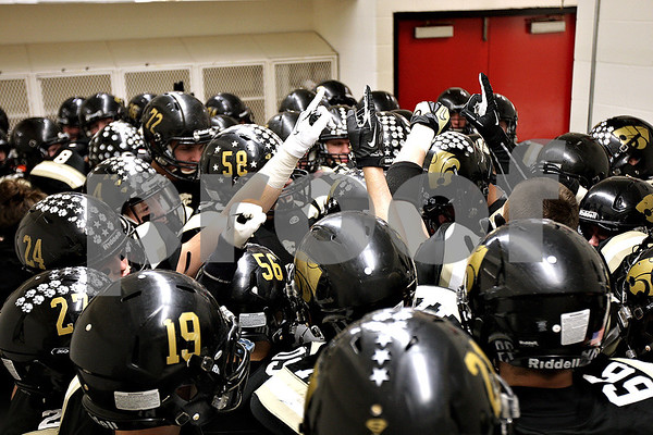 Monica Maschak - mmaschak@shawmedia.com<br /> The team huddles up to hear their captains talk in the locker room before taking the field for the IHSA Class 1A Football Championships at Huskie Stadium on Friday, November 29, 2013.