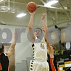 Rob Winner – rwinner@shawmedia.com<br /> <br /> Sycamore's Brian Huber (42) takes a shot in the first half during a game against Sandwich at the Strombom tournament in Sycamore, Ill., Monday, Nov. 25, 2013.