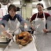 Monica Maschak - mmaschak@shawmedia.com<br /> Food Service Director Vickey Hagerman pulls a cooked turkey before deboning the bird as cook Eva Trutwin watches at Barb City Manor Retirement Center on Wednesday, November 27, 2013. Four 22-pound turkeys were cooked in preparation for Thanksgiving.