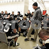 Monica Maschak - mmaschak@shawmedia.com<br /> Head coach Ric Arand gives a pep talk to his team before taking the field for an IHSA Class 1A Football Championship game against Tri-Valley at Huskie Stadium on Friday, November 29, 2013.