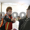Rob Winner – rwinner@shawmedia.com<br /> <br /> Volunteer Lisa Small of DeKalb helps serve free hot drinks inside the Spirit Zone hospitality tent outside Huskie Stadium in DeKalb, Ill., Friday, Nov. 29, 2013.