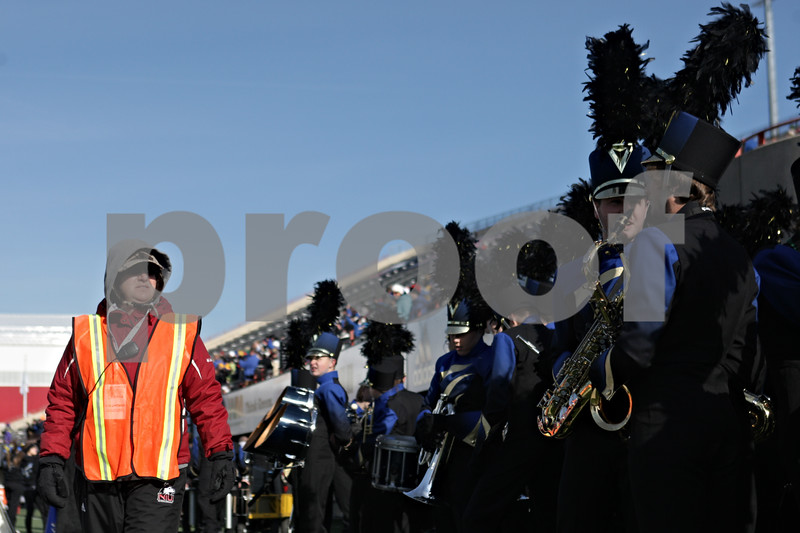 Rob Winner – rwinner@shawmedia.com<br /> <br /> Volunteer Linda Krone of Cortland walks along the sidelines as the Downs Tri-Valley marching band gathers before halftime at Huskie Stadium in DeKalb, Ill., Friday, Nov. 29, 2013.ds