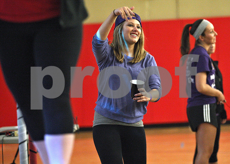 Monica Maschak - mmaschak@shawmedia.com<br /> Kelly Iseli, 21, dances to music during a dance marathon to raise money for Children's Miracle Network at the Northern Illinois University Recreation Center on Saturday, November 23, 2013. All money raised will help the Ann and Robert H. Lurie Children's Hospital of Chicago.