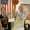 Rob Winner – rwinner@shawmedia.com<br /> <br /> Sycamore's Devin Mottet (15) goes to the basket in the first quarter during a game against Sandwich at the Strombom tournament in Sycamore, Ill., Monday, Nov. 25, 2013.