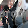Monica Maschak - mmaschak@shawmedia.com<br /> Lena-Winslow head coach Ric Arand lifts ballboy Luke Benson to touch Jordan Lynch's name on the wall of the Yordon Center before the IHSA Class 1A Football Championships at Huskie Stadium on Friday, November 29, 2013.