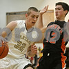 Rob Winner – rwinner@shawmedia.com<br /> <br /> Sycamore's Cooper Vinz (32) moves the ball while being pressured by Sandwich's Daulton Murphy in the first quarter of their game during the Strombom tournament in Sycamore, Ill., Monday, Nov. 25, 2013.