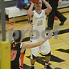 Rob Winner – rwinner@shawmedia.com<br /> <br /> Sycamore's Riley Hurley (23) puts up three points with a field goal in the second quarter during a game against Sandwich at the Strombom tournament in Sycamore, Ill., Monday, Nov. 25, 2013.