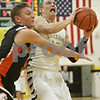Rob Winner – rwinner@shawmedia.com<br /> <br /> Sycamore's Devin Mottet (right) looks to shoot in the first quarter during a game against Sandwich at the Strombom tournament in Sycamore, Ill., Monday, Nov. 25, 2013.