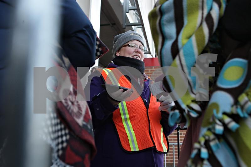 Rob Winner – rwinner@shawmedia.com<br /> <br /> Volunteer Lisa Cowley of DeKalb scans tickets as fans arrive at Huskie Stadium in DeKalb, Ill., Friday, Nov. 29, 2013.