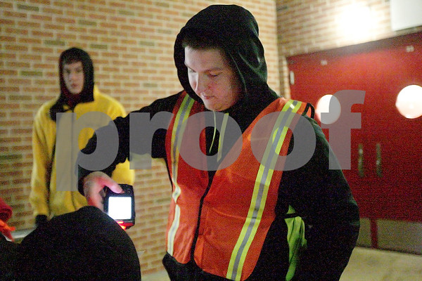 Monica Maschak - mmaschak@shawmedia.com<br /> Volunteer Skylar Zimmerman, from Kishwaukee College, scans tickets at a gate at Huskie Stadium on Wednesday, November 13, 2013. Zimmerman was training to scan tickets at the IHSA State Football Championships.