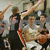 Rob Winner – rwinner@shawmedia.com<br /> <br /> Sycamore's Devin Mottet (15) is pressured while driving to the basket in the first quarter during a game against Sandwich at the Strombom tournament in Sycamore, Ill., Monday, Nov. 25, 2013.
