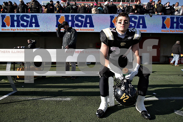 Monica Maschak - mmaschak@shawmedia.com<br /> Defensive back Tyler Oakley rests after scoring two turnover touchdowns in the first quarter against Tri-Valley in the IHSA Class 1A Football Championships at Huskie Stadium on Friday, November 29, 2013.