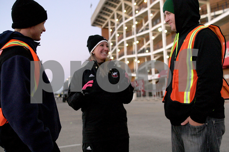 Monica Maschak - mmaschak@shawmedia.com<br /> Game day Operation Staff member Michele Bailen (center) talks to volunteers Adam Seiter, 19, and Skylar Zimmerman, 20, before their training at Huskie Stadium on Wednesday, November 13, 2013. Seiter and Zimmerman will be scanning tickets for entrance into the IHSA State Football Championships.