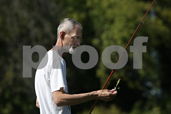 Rob Winner – rwinner@shawmedia.com<br /> <br /> Kingston resident Mitch Cave removes debris from his lure between casts while fishing for largemouth bass in the Kishwaukee River off of Route 64 near Old State Road in Sycamore on Tuesday afternoon.<br /> <br /> Tuesday, Oct. 1, 2013
