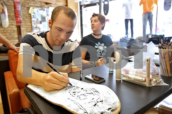 Monica Maschak - mmaschak@shawmedia.com<br /> Artists Ryan Lindsey and Spencer Siebeck, both from Sycamore High School, repurpose broken skateboards into their own art at the SMLTWN SK8 shop during an Art Walk in Sycamore and in DeKalb on Saturday, September 28, 2013.