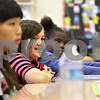 Monica Maschak - mmaschak@shawmedia.com<br /> Third-grade students Julia Kim (left), Emma Haug and Micahya Burrage listen and participate during a Coordinated Approach to Child Health (CATCH) training day at Jefferson Elementary School on Wednesday, April 24, 2013. Children at Sycamore and DeKalb school districts are taught how to make healthier lifestyle choices throughout their elementary years.