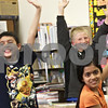 Monica Maschak - mmaschak@shawmedia.com<br /> Third-grade students Nathan Beard, Jack Keck and Anurupa Adhikari raise their hands while participating in a Coordinated Approach to Child Health (CATCH) training day activity at Jefferson Elementary School on Wednesday, April 24, 2013. Children at Sycamore and DeKalb school districts are taught how to make healthier lifestyle choices throughout their elementary years.