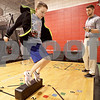 Monica Maschak - mmaschak@shawmedia.com<br /> Will Lynch, 9, of DeKalb jumps back and forth over a block during his plyometric exercises lead by sports performance specialist Toby Knapek at the FitWorkz in DeKalb on Wednesday, September 18, 2013.