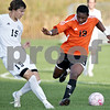 Monica Maschak - mmaschak@shawmedia.com<br /> Chris Van Dinther (15) and Akim Suraji (19) go head to head for the ball in the first half of DeKalb at Kaneland on Thursday, October 3, 2013. DeKalb won 2-1.