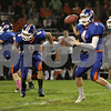 Rob Winner – rwinner@shawmedia.com<br /> <br /> Genoa-Kingston quarterback Griffin McNeal (4) looks for an open receiver during the first quarter in Genoa, Ill., Friday, Oct. 4, 2013.