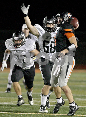 Monica Maschak - mmaschak@shawmedia.com<br /> Linebacker Jake Gomes (68) pressures quarterback Jack Sauter in the first quarter against Kaneland at DeKalb High School on Friday, October 4, 2013.