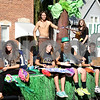 Monica Maschak - mmaschak@shawmedia.com<br /> The junior class tossed candy to spectators on their jungle-themed float during the Hiawatha homecoming parade on Wednesday, October 2, 2013. Each class had their own themed float.