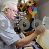 Monica Maschak - mmaschak@shawmedia.com<br /> Watercolor artist Graydon Cafarella paints an ocean scene from a photo he took himself during an Art Walk in Sycamore and in DeKalb on Saturday, September 28, 2013.