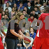 Rob Winner – rwinner@shawmedia.com<br /> <br /> Senior Kristen Bussen reacts after dropping a basketball during a demonstration by Harlem Wizards players Marvin Jackson (left) and Eric Jones (right) at Genoa-Kingston High School on Wednesday, Oct. 2, 2013. The Harlem Wizards were visiting to promote their game against a Genoa-Kingston booster team which will be played on Sunday, November 3.