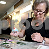 Monica Maschak - mmaschak@shawmedia.com<br /> Fused-glass artist Susan Delaney, of DeKalb, works with glass to make Christmas ornaments at Art Attack during an Art Walk in Sycamore and in DeKalb on Saturday, September 28, 2013.