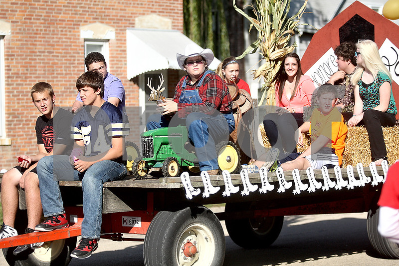 Monica Maschak - mmaschak@shawmedia.com<br /> The sophomore class rode along on their country-themed float during the Hiawatha homecoming parade on Wednesday, October 2, 2013. Each class had their own themed float.