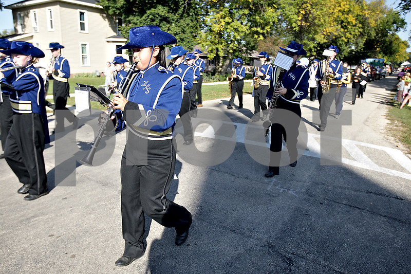 Monica Maschak - mmaschak@shawmedia.com<br /> The marching band lead the Hiawatha homecoming parade on Wednesday, October 2, 2013. Each class had their own themed float.
