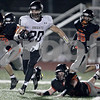 Monica Maschak - mmaschak@shawmedia.com<br /> DeKalb's defense chases after ball carrier Dylan Nauert in the second quarter against Kaneland at DeKalb High School on Friday, October 4, 2013.