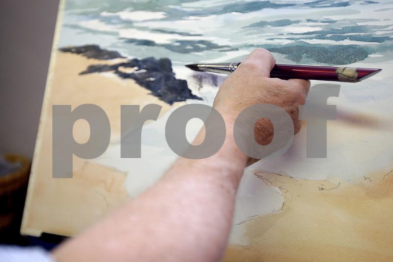 Monica Maschak - mmaschak@shawmedia.com<br /> Watercolor artist Graydon Cafarella paints an ocean scene from a photo he took himself during an Art Walk in Sycamore and in DeKalb on Saturday, September 28, 2013.