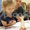 Monica Maschak - mmaschak@shawmedia.com<br /> Colette Reedman, 4, picks out paper cutouts of food to put on her My Plate as her dad, Scotty Reedman, looks on during Healthy Kids Day at the Kishwaukee YMCA on Saturday, April 27, 2013. The event was for kids in the county to get up and get moving as part of a national YMCA movement to promote healthier lifestyles for children. The event featured educational and physical activities such as games for families, bounce houses and a bike rodeo.