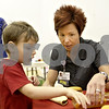Monica Maschak - mmaschak@shawmedia.com<br /> Kishwaukee Hospital Community Health Liason Lisa Cumings, RN teaches Chris Graff, 4, about My Plate and foods with saturated fats during Healthy Kids Day at the Kishwaukee YMCA on Saturday, April 27, 2013. The event was for kids in the county to get up and get moving as part of a national YMCA movement to promote healthier lifestyles for children. The event featured educational and physical activities such as games for families, bounce houses and a bike rodeo.