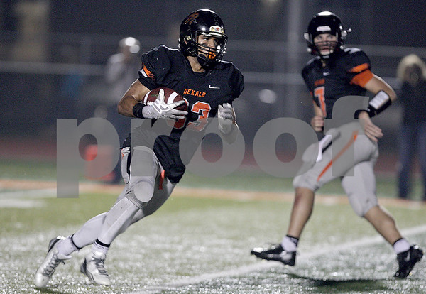 Monica Maschak - mmaschak@shawmedia.com<br /> Drew Brown attempts to gain yards in the second quarter against Kaneland at DeKalb High School on Friday, October 4, 2013.
