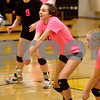 Monica Maschak - mmaschak@shawmedia.com<br /> Kayla Schafer bumps to a setter in the second of two sets at Sycamore High School on Thursday, October 10, 2013. DeKalb won the match.