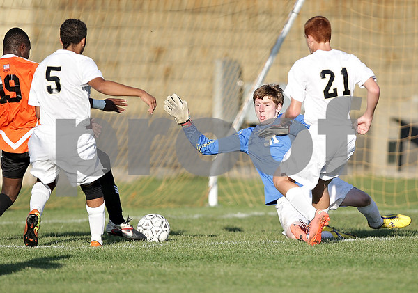 Monica Maschak - mmaschak@shawmedia.com<br /> Goalkeeper Dylan Nelson misses the save on a goal from Akim Suraji in the first half of the game at Sycamore High School on Thursday, October 10, 2013. DeKalb beat Sycamore 7-0.